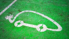 Electric car charging point at parking lot