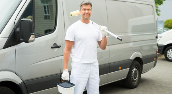 Painter Standing In Front Of Van